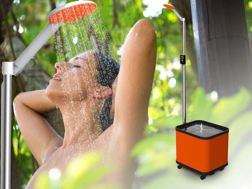 Woman using a Petra's portable shower outdoors.