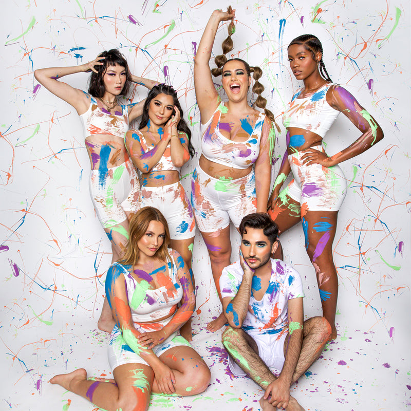 Campaign picture from Beautiful Mess Photoshoot with Models splattered in different colored paint