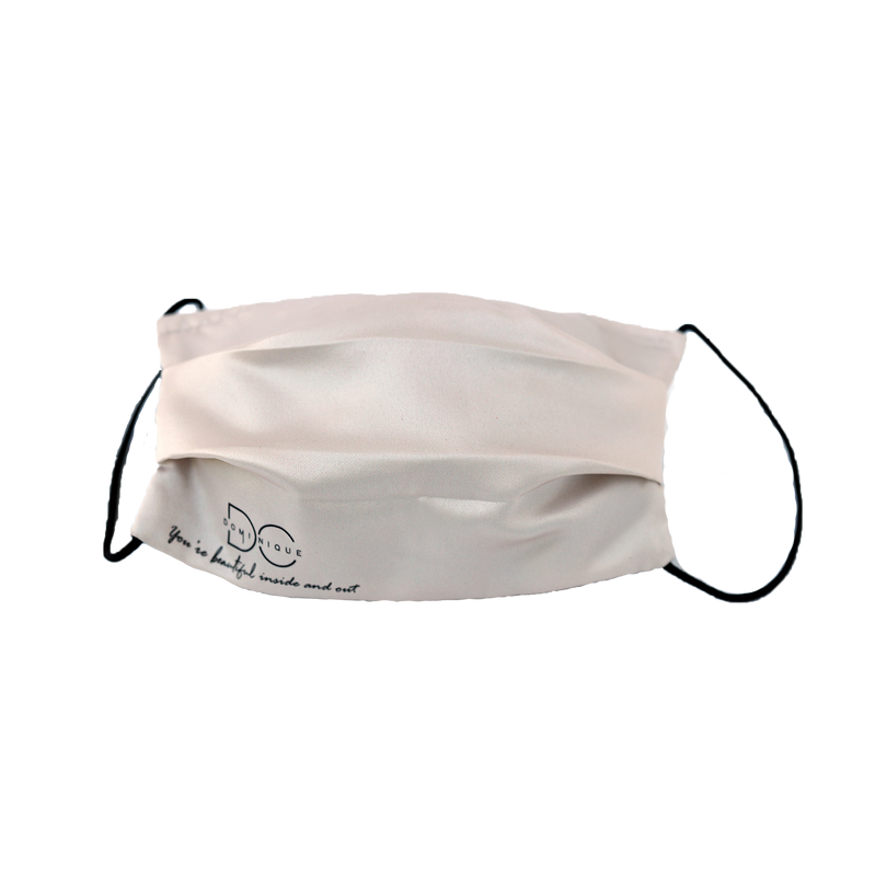 Champagne colored side of the DC reversible Satin Face Mask with black logo