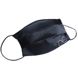 Black side of the DC reversible satin face mask with nude logo