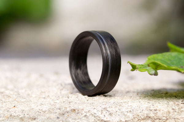 Men's undirectional carbon fiber ring. Unique black wedding band with one stripe. (00131) - Rosler Rings