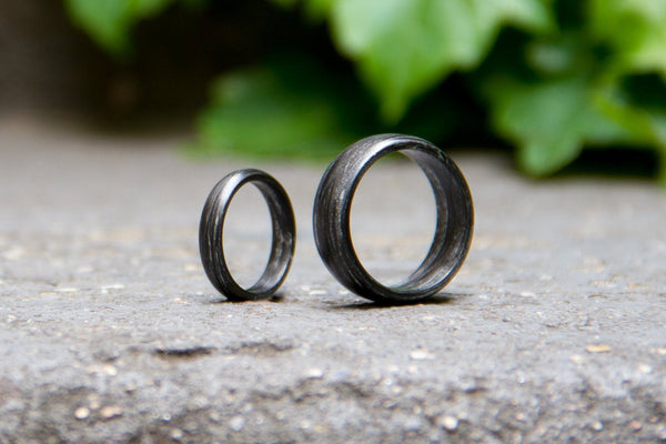 Set of two carbon fiber and silver wedding bands. Unique and modern black rings. (00110) - Rosler Rings