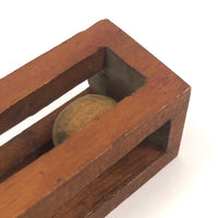 Geometric Carved Ball in Cage Whimsy