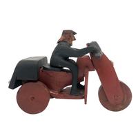 Hard-carved Man in Black with Mullet on (Three-wheeled) Motorcycle