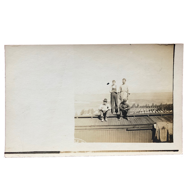 Four Young Men on Train Car Old Real Photo Postcard
