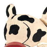 Black and White Dog on Red Wheels Old Wooden Pull Toy