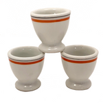 Set of Three French Porcelain Egg Cups with Orange Banding