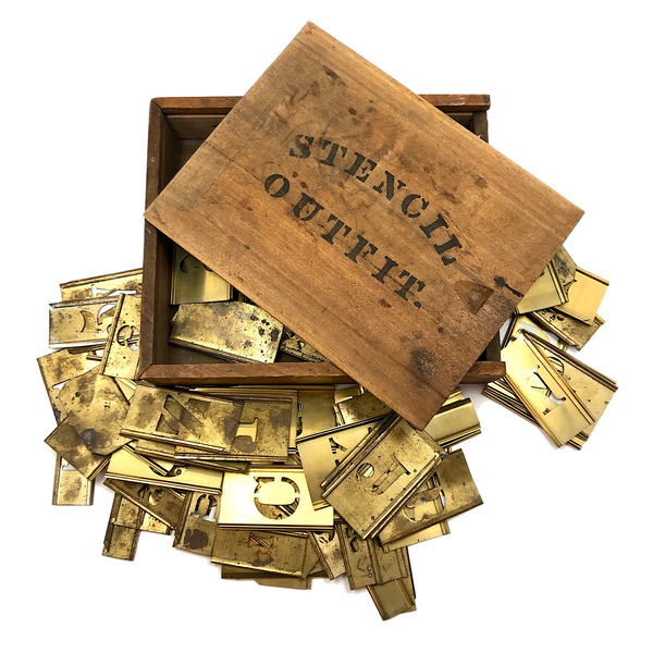 "Assorted Brass Stencils in Old ""Stencil Outfit"" Slide Top Box, c. 1940s"