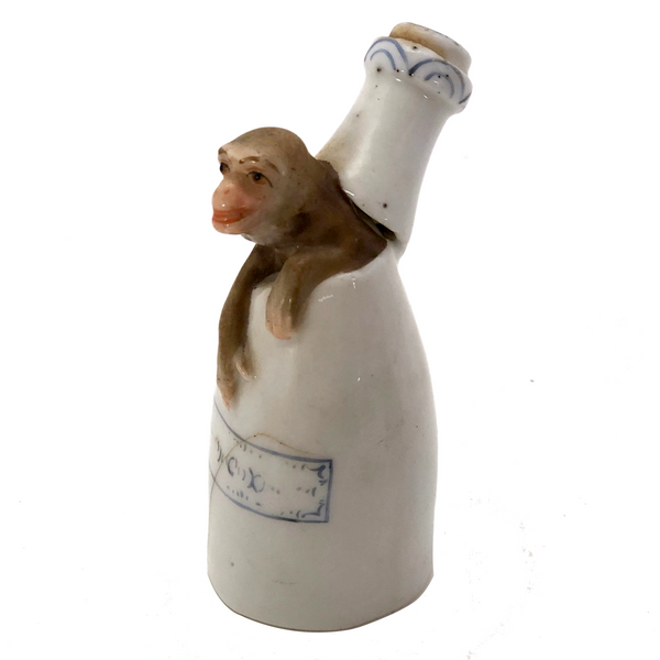 Antique Hand-painted Porcelain Bottle-Shaped Candlesnuffer with Monkey!