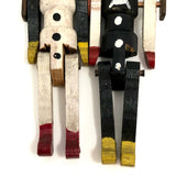 Black and White Pair of Jointed Wooden Figures on Hanger