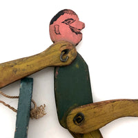 Colorful Old Wooden Acrobat Squeeze Toy on Stand