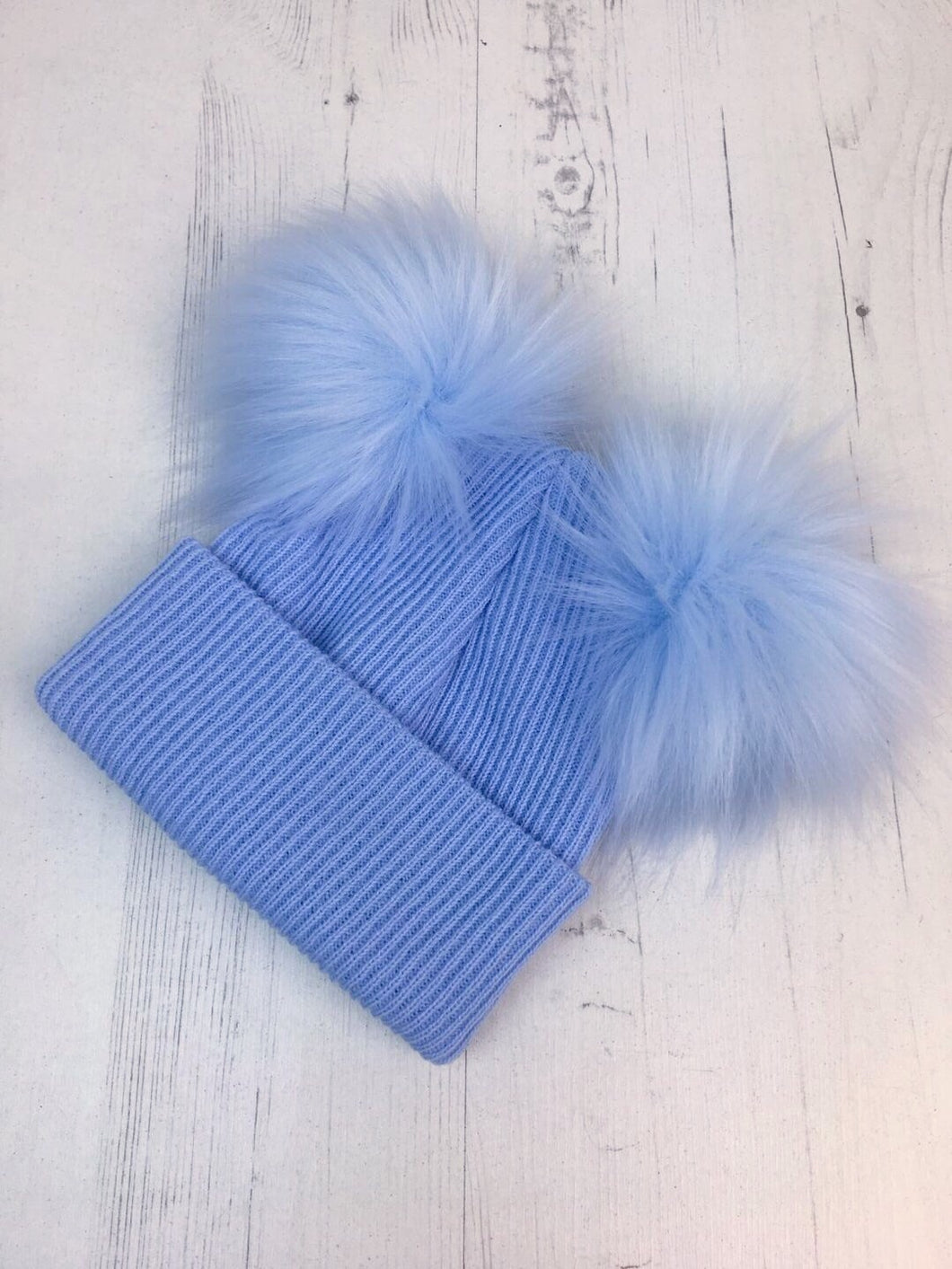 e168fc731e8 Blue Faux Fur Double Pom Pom Hat – Laila Lou Childrenswear