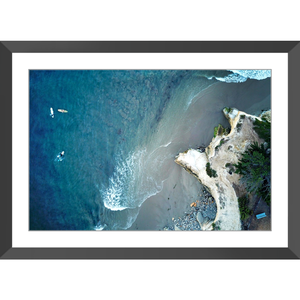 Three Surfers Framed Print