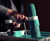 Paint roller sleeve cleaner