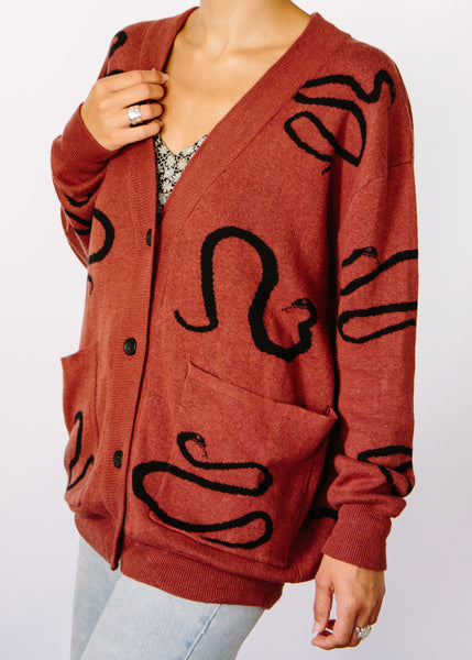 Saylor Snake Hemp + Organic Cotton Cardigan Sweater. Color is Rust.