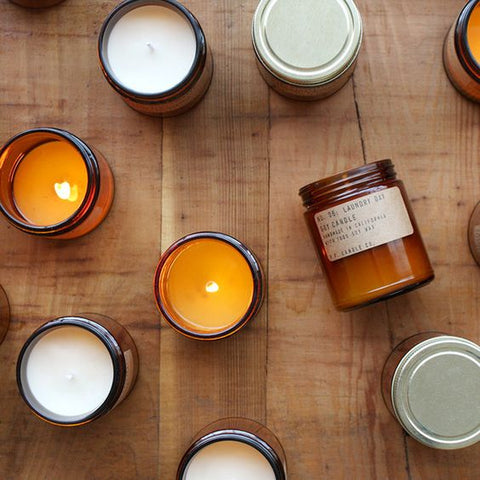 P.F. Candle Co. collection of natural soy wax scented candles, hand poured in California into amber glass apothecary inspired jars