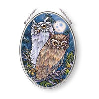 pair of owls with moon behind them