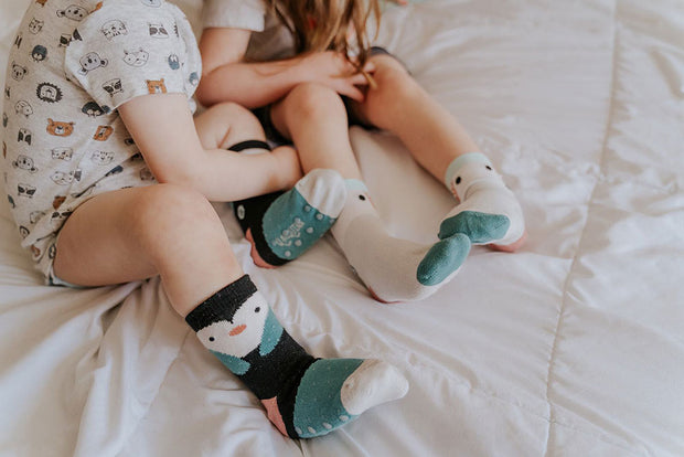 Little girls wearing 'Arctic Animals' socks