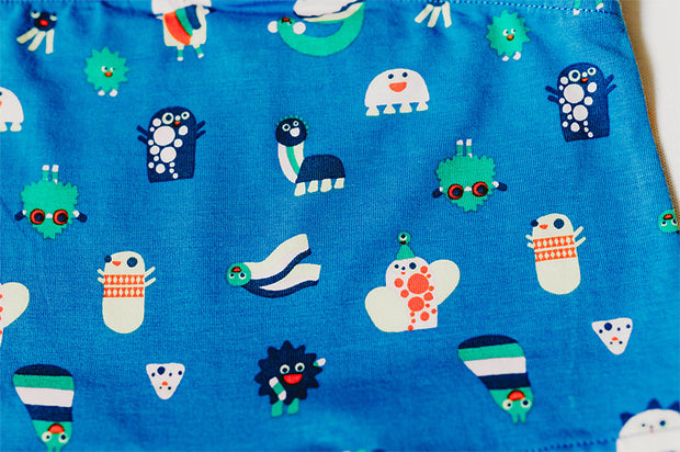 closeup of organic cotton fabric with funny creatures print