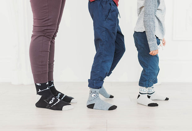 mom with kids wearing matching monster socks