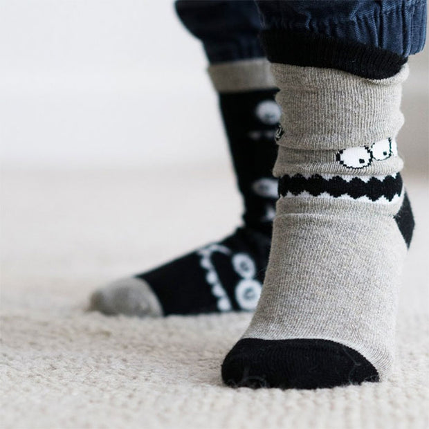 child wearing seamless socks in monochrome monsters design | Q for Quinn