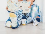 2 boys wearing organic cotton socks and pyjamas