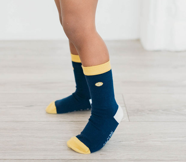 boy wearing blue and yellow organic cotton socks