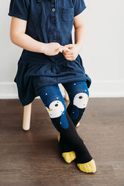 Little girl wearing penguin tights | Q for Quinn
