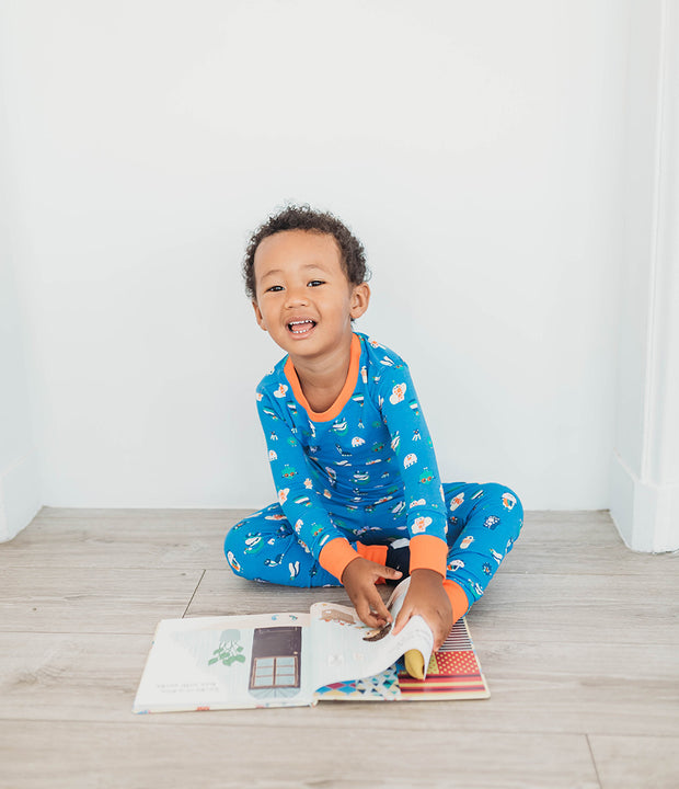 little boy reading wearing organic cotton pyjamas
