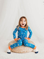 little girls smiling with funny creatures pyjamas