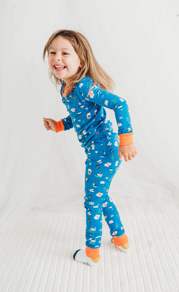 little girl smiling with funny creatures pyjamas
