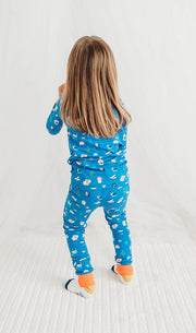 little girl dancing wearing funny creatures pyjamas