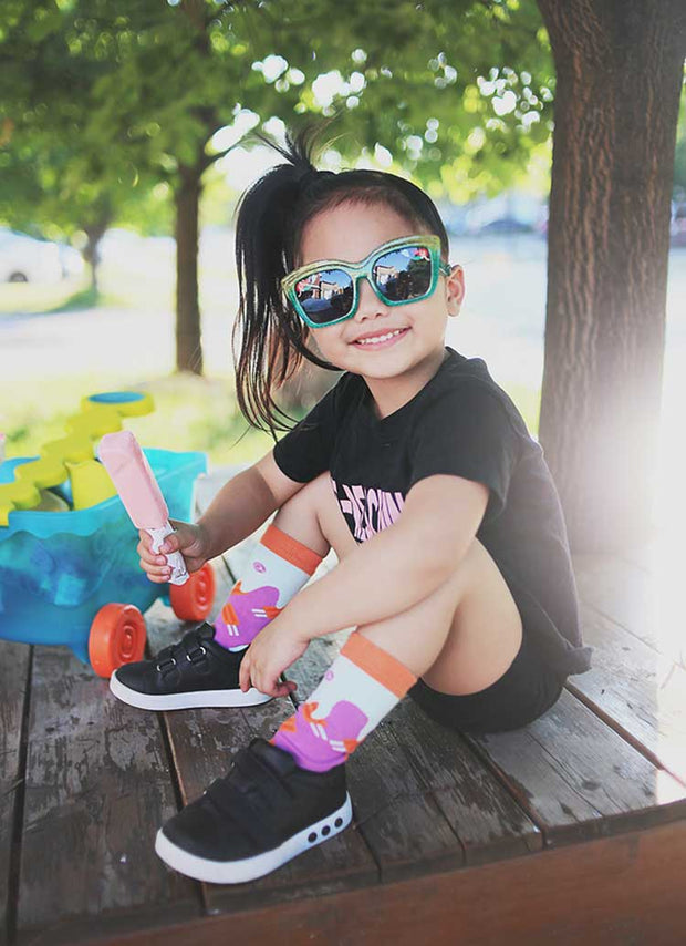 Cool little girl with sunglasses and a popsicle, wearing matching popsicle socks | Q for Quinn