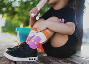 Little girl enjoying a popsicle, while wearing matching popsicle socks | Q for Quinn