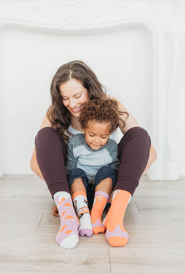 Mom and kid wearing fun popsicle socks