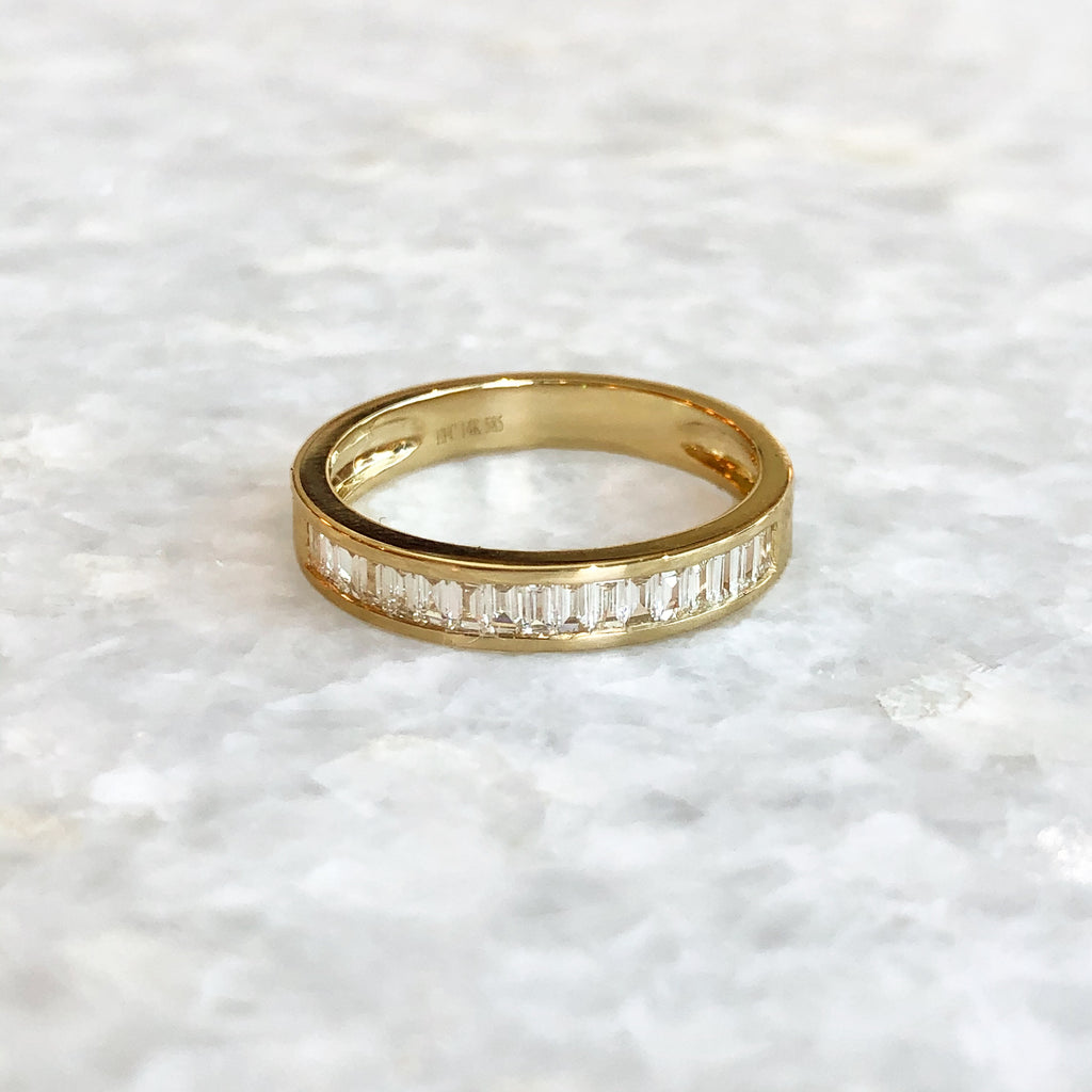 half diamond channel set baguette band ring