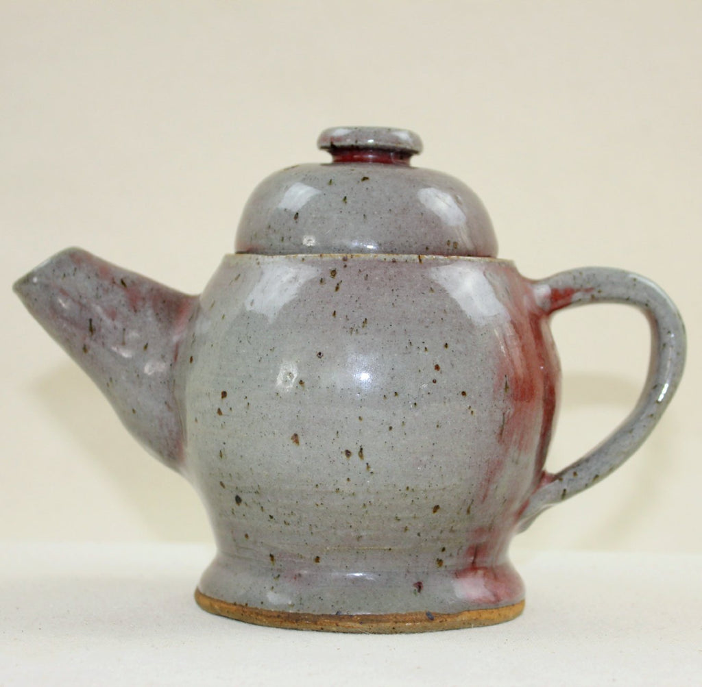 Gray and red teapot