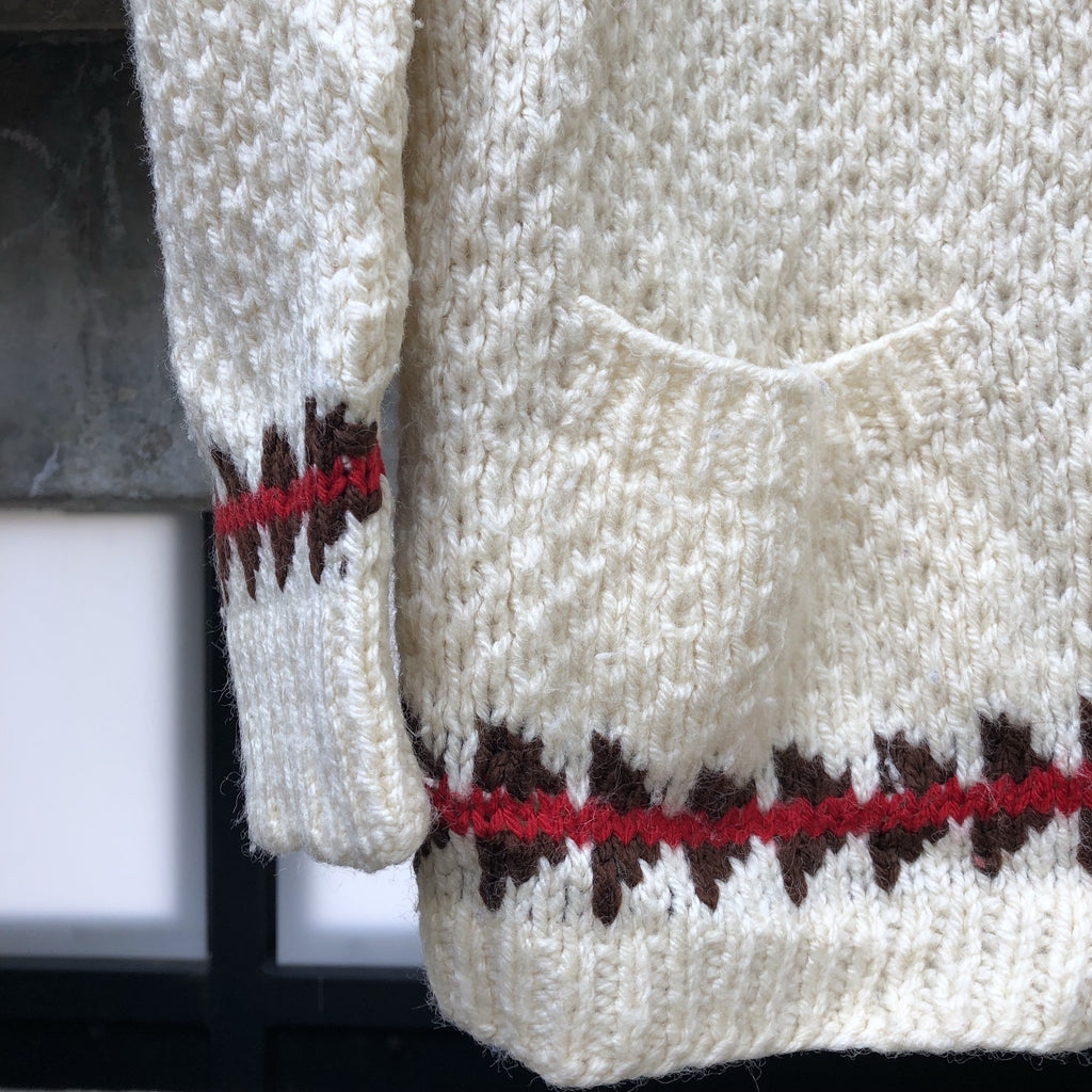 Chunky knit cardigan with red and brown border trim