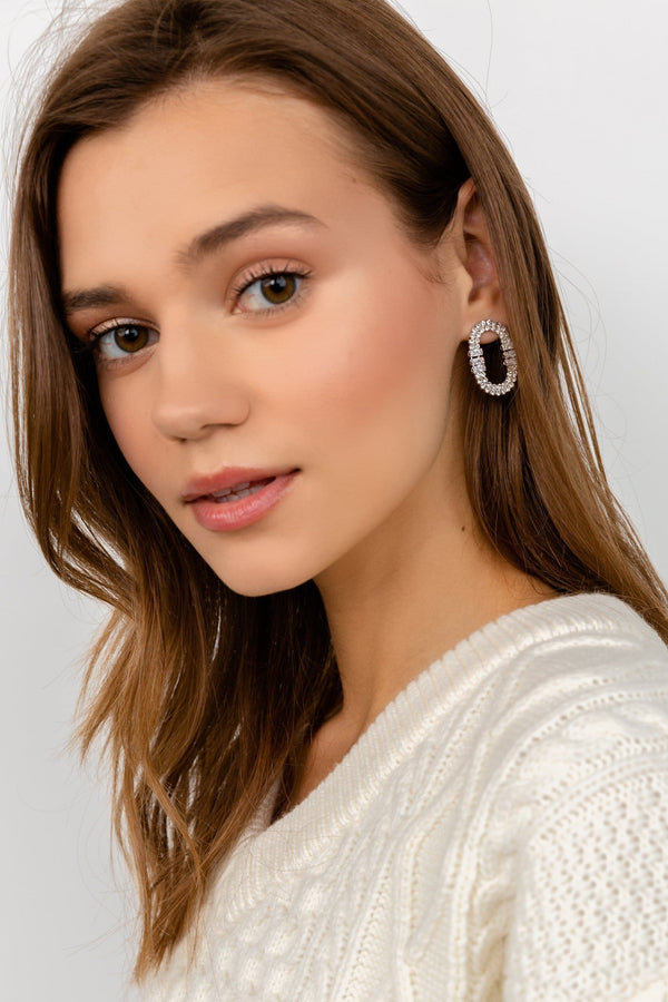 Silver earrings encrusted in crystals in oval shape | J.ING women's accessories
