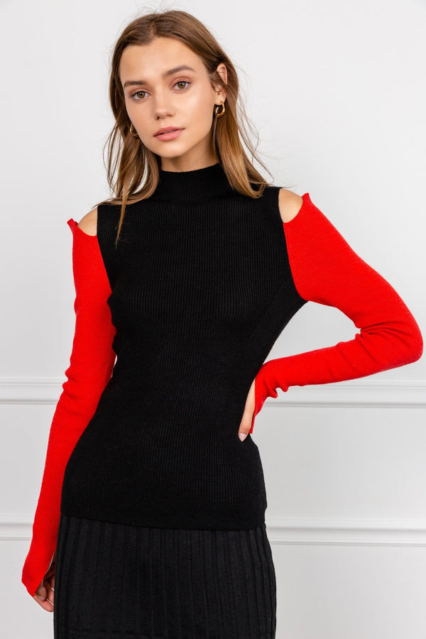 Black high neck sweater with cold shoulders and red long sleeves