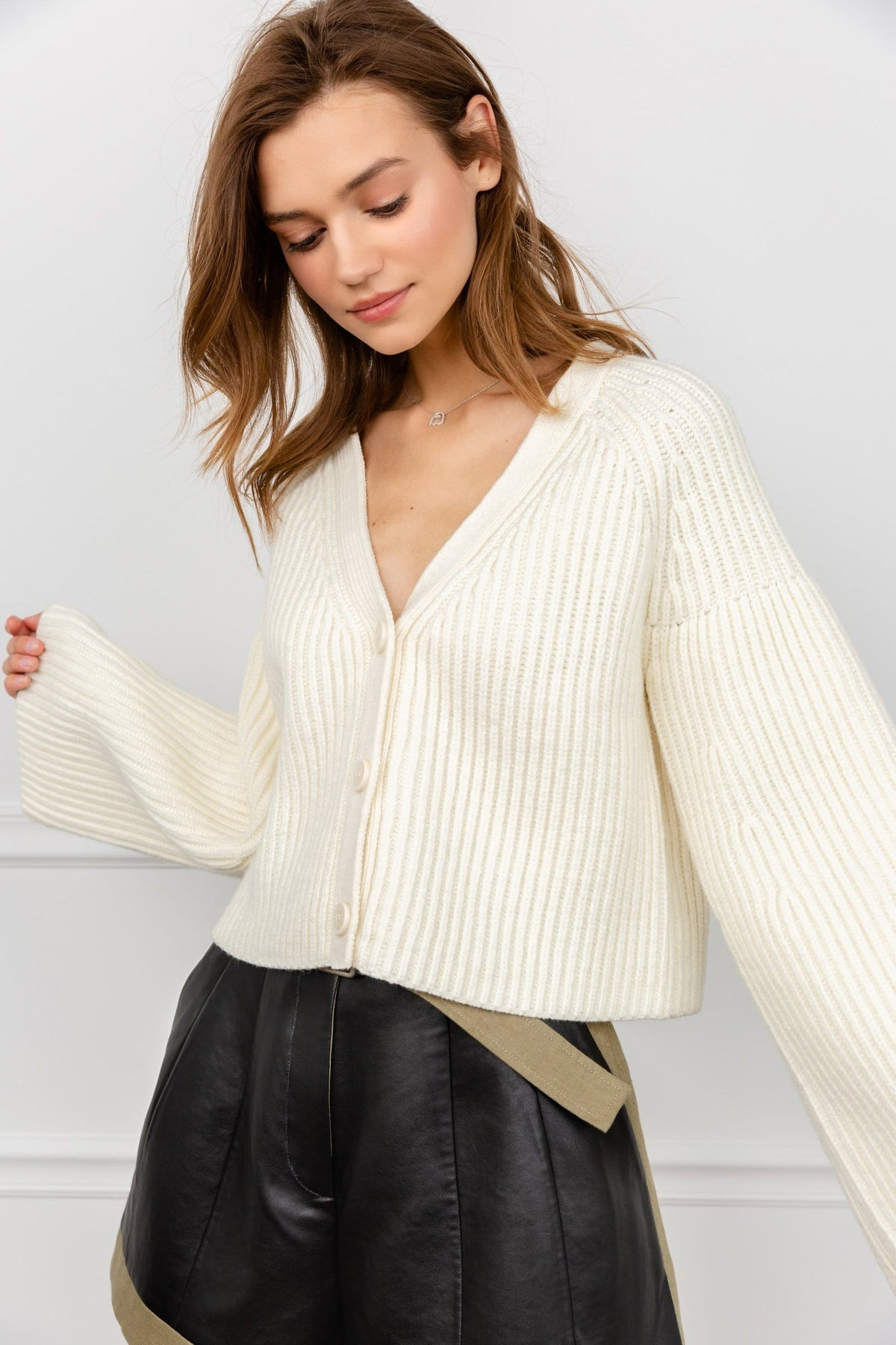 Girl in White Button Up Knitted Cardigan