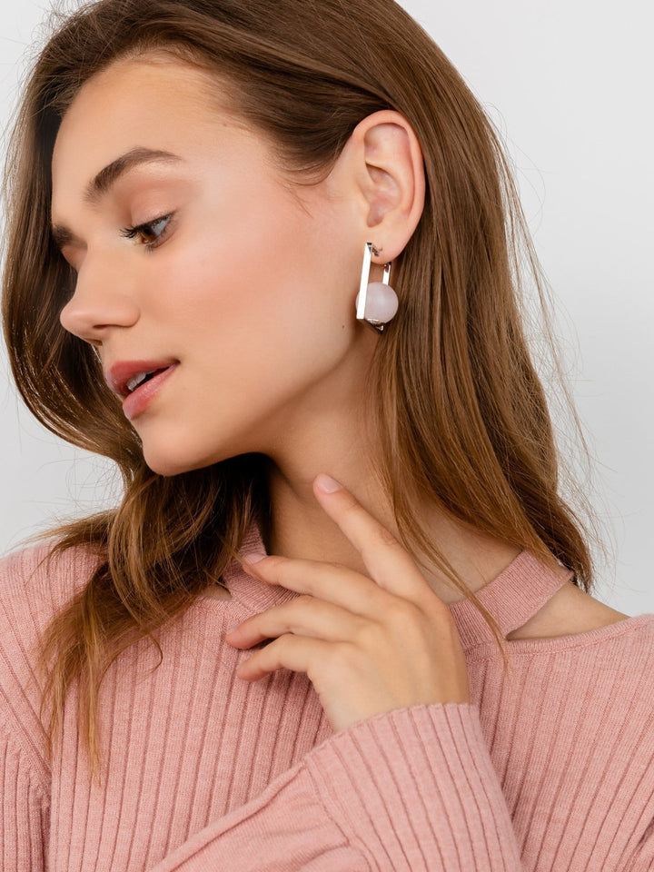 Silver square shaped earring featuring large pink stone in the middle | J.ING women's accessories