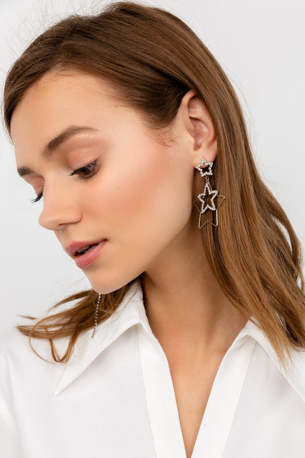 Silver asymmetrical star earrings featuring zircon crystals and tassels | J.ING women's earrings