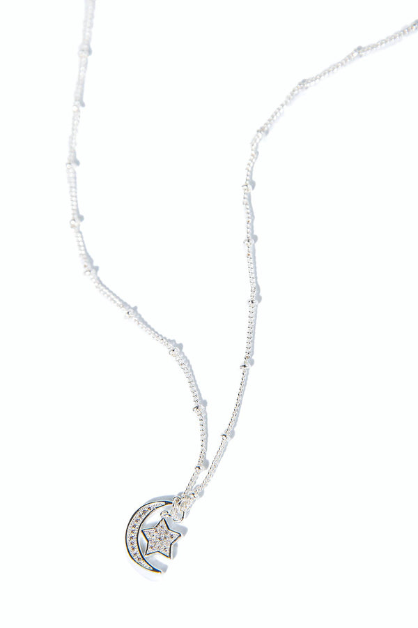 silver necklace with star and crescent moon pendant encrusted in faux crystals | J.ING women's accessories