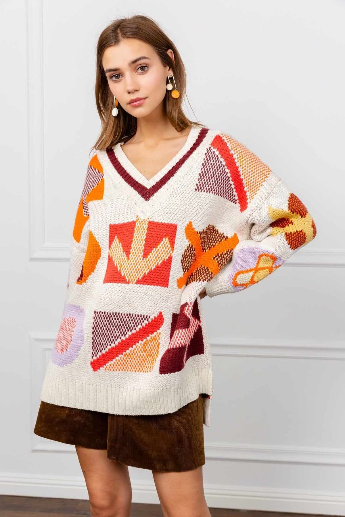 Oversize White Sweater with Orange knitted Symbols | J.ING Women's Knitwear