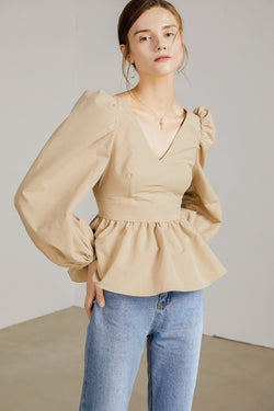 Light tan peplum top with long peasant sleeves by J.ING Women's Apparel
