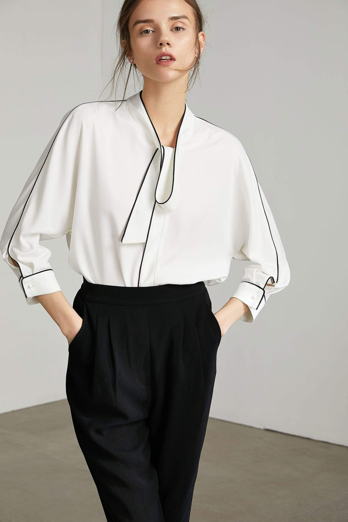 Chic white blouse with necktie and contrast stitch piping by J.ING