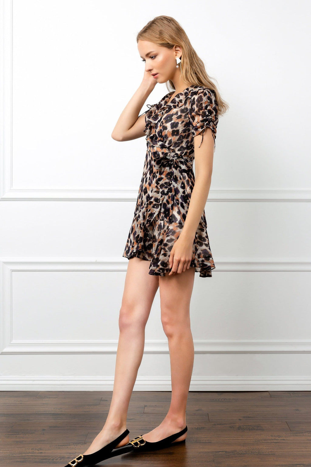 Profile view of leopard short dress by J.ING