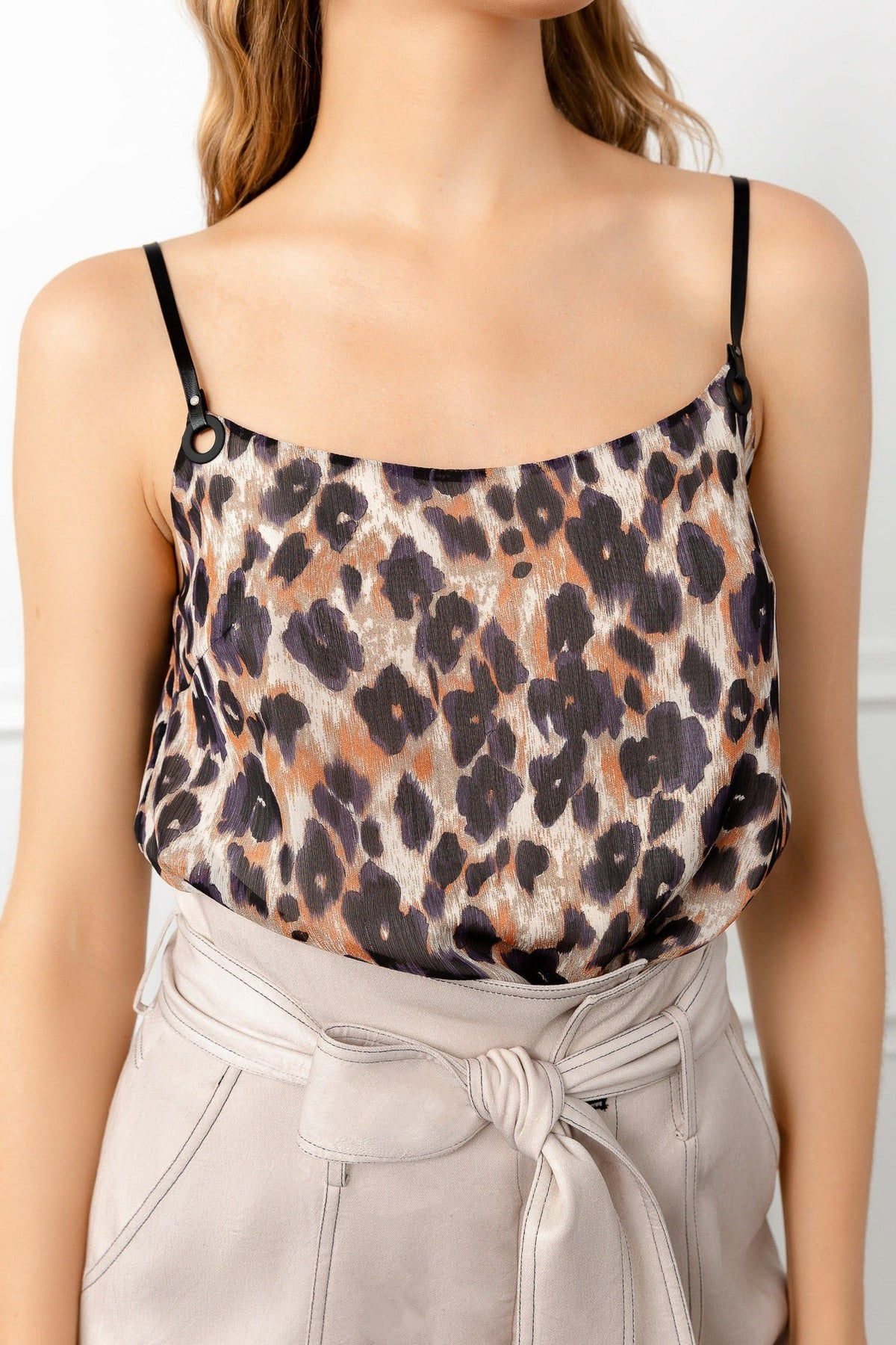 shot of leopard spaghetti strap top in brown color by j.ing