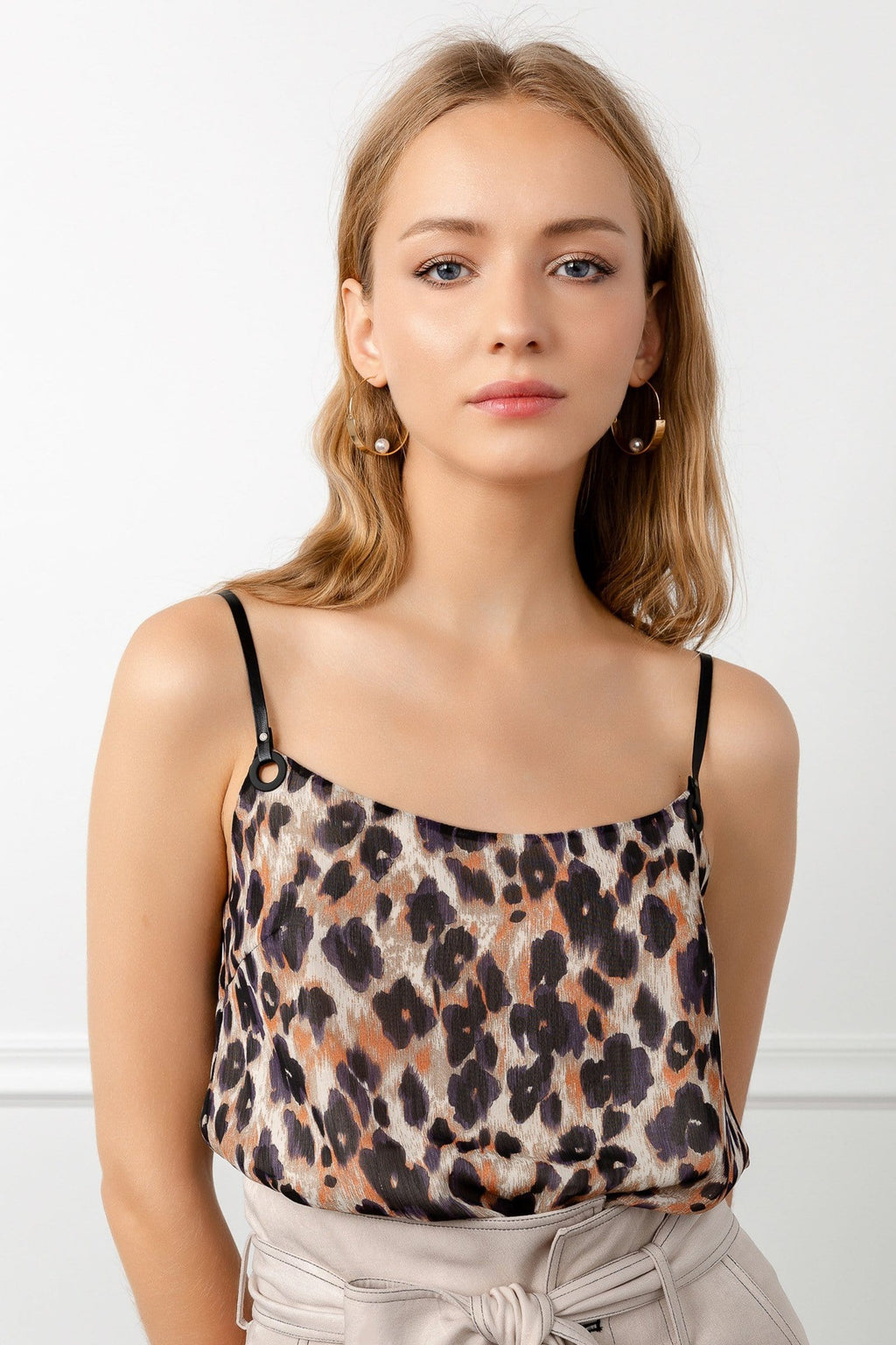 blonde girl wearing brown leopard spaghetti strap top by j.ing